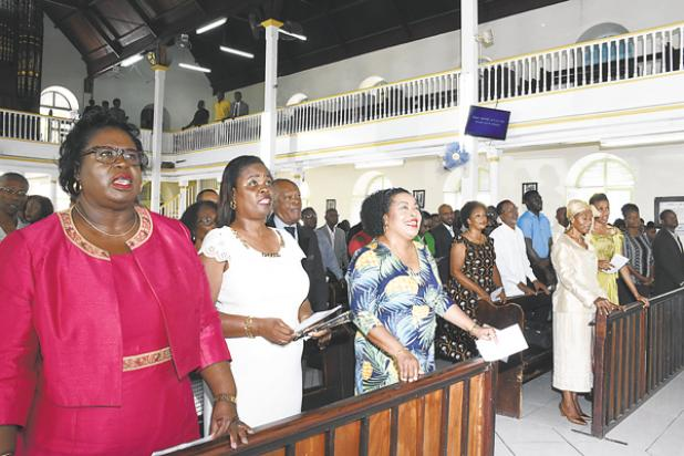 Minister of Information, Broadcasting and Public Affairs, Senator Lucille Moe (third from left), joins the staff of the Barbados Government Information Service (BGIS) as they celebrate their 60th anniversary with God's blessing at Calvary Moravian Church yesterday.