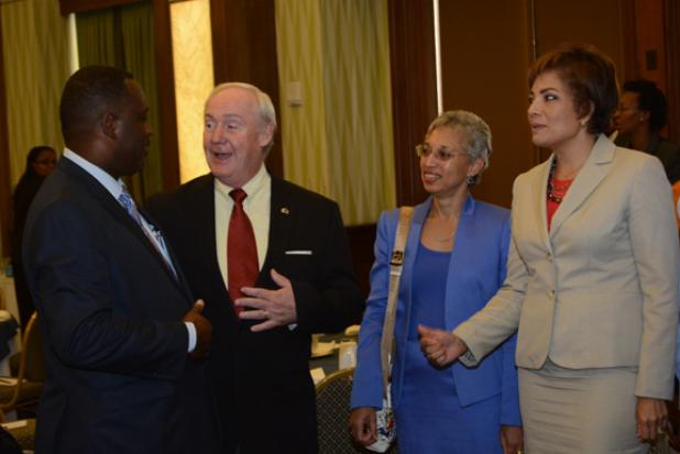 (L-R) Minister of Industry, International Business, Commerce, and Small Business Development, Donville Inniss greets Chairman of BIBA (Canada), Dr. Thomas Sears; Partner at the law firm Clarke Gittens Farmer, Attorney-at-law Gillian Clarke; and Managing Director of Tricor Caribbean, Connie Smith, after the ISM launch yesterday at the Hilton.