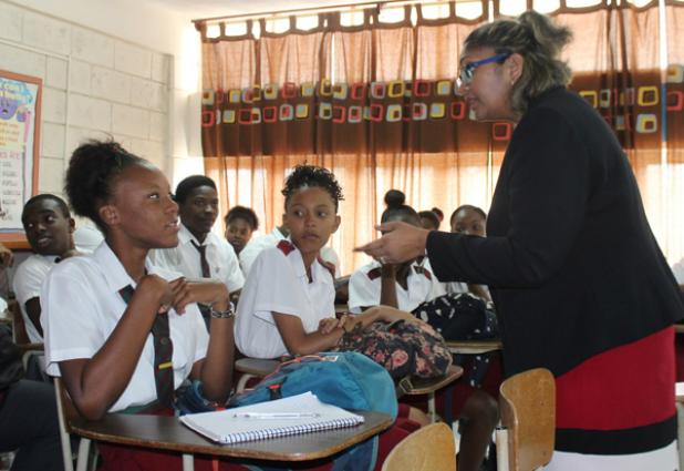Scotiabank's Belinda Maraj, right, Assistant Manager for Learning & Development, listening to a question from student Shakalah Burke (left) during the 'Preparing for the World of Work' road show recently.