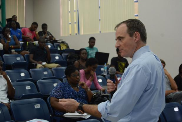 Dr. Simon Johnson speaking to students.