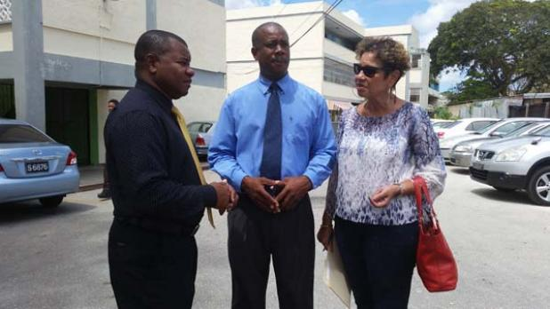 FROM LEFT: Principal of Ellerslie School, Major Errol Brathwaite speaking with Barbados Union of Teachers (BUT) President, Pedro Shepherd, and President of the Barbados Secondary Teachers' Union (BSTU), Mary Ann Redman, after a meeting at the school  yesterday.