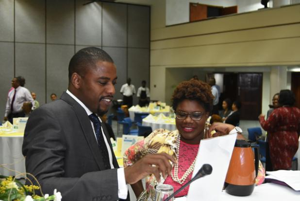 Regional Director for IT Solutions at Cable and Wireless Business, Jenson Sylvester, in conversation with Executive Director of the Barbados Chamber of Commerce and Industry (BCCI), Lisa Gale at yesterday's BCCI luncheon.