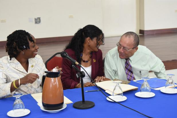 Minister of Labour, Social Security and Human Resource Development, Senator Dr. Esther Byer Suckoo in talks with Executive Director of the Barbados Employers' Confederation (BEC), Anthony Walcott (right), as General Secretary of the Barbados Workers' Union (BWU), Toni Moore looks on ahead of the opening of the  workshop entitled 'Workplace Stress: A Collective Challenge', which was held at Solidarity House yesterday.