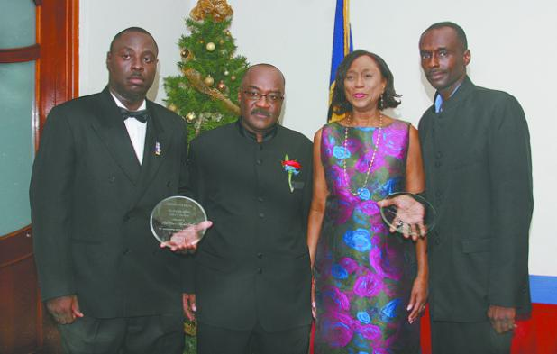 Marlon Small (left) and Terry Griffith (right) were presented with the Chief Fire Officer's Award. They are pictured here with Chief Fire Officer, Errol Maynard and Permanent Secretary in the Ministry of Home Affairs, Gayle Francis-Vaughan.