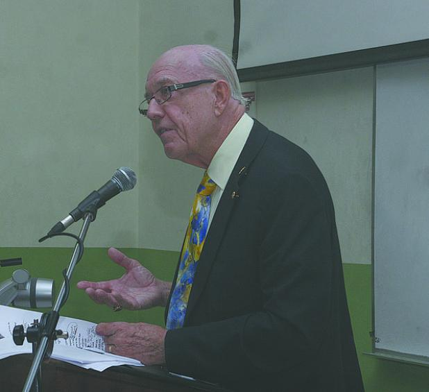 Professor Emeritus of the University of the West Indies, Sir Henry Fraser,  delivering the public lecture.