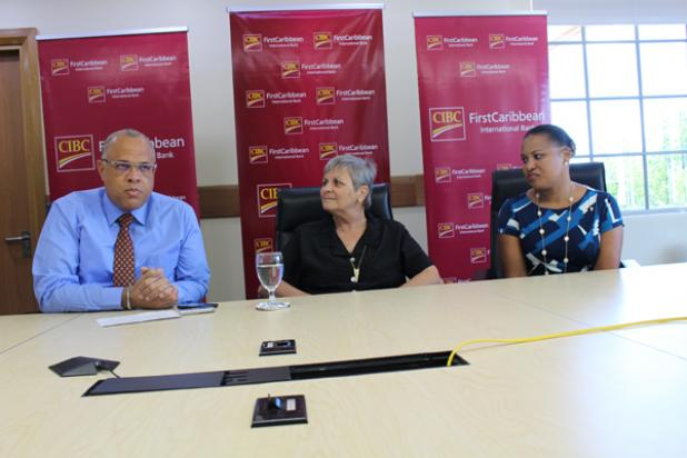 Mark St. Hill, Managing Director, Retail and Business Banking, CIBC FirstCaribbean International Bank (left) makes a point as United Caribbean Trust (UCT) Head, Jenny Tryhane (centre) and Donna Wellington, Managing Director, Barbados Operating Company, CIBC FirstCaribbean International Bank (right) look on during a press conference at their Warrens location.