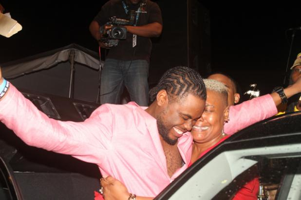 An ecstatic Stiffy shares the moment of jubilation with his mother before stepping into his Kia Picanto, after being named the winner of the Barbados Yellow Pages Bashment Soca competition on Friday night at the Kensington Oval.