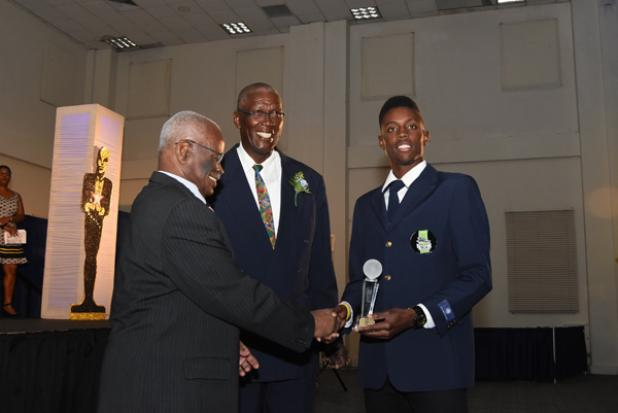 Shamar Springer (right) being congratulated by Governor General Sir Elliott Belgrave (left) after winning the President's Award during the Barbados Cricket Association's Awards Ceremony last Saturday evening at the Lloyd Erskine Sandiford Centre. Looking on is BCA President, Joel Garner.