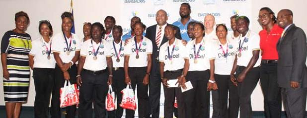 Government and Digicel officials pose with members of the West Indies Women's and Men's teams.