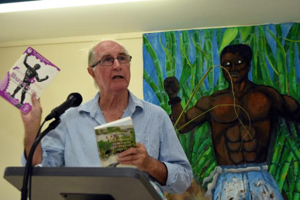 Historian Dr. Karl Watson as he showcased some of the available literature on the 1816 rebellion in Barbados, as he delivered a lecture in commemoration of the bicentenary of that historic event.