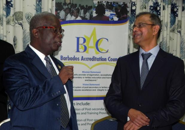 Minister of Education, Science, Technology and Innovation, Ronald Jones engages Acting Director of the Mauritius Qualifications Authority (MQA) Robin Phoolchund, during a break from the National Qualifications Framework (NQF) Implementation Workshop. The Authority will be assisting Barbados in establishing its National Qualifications Framework.