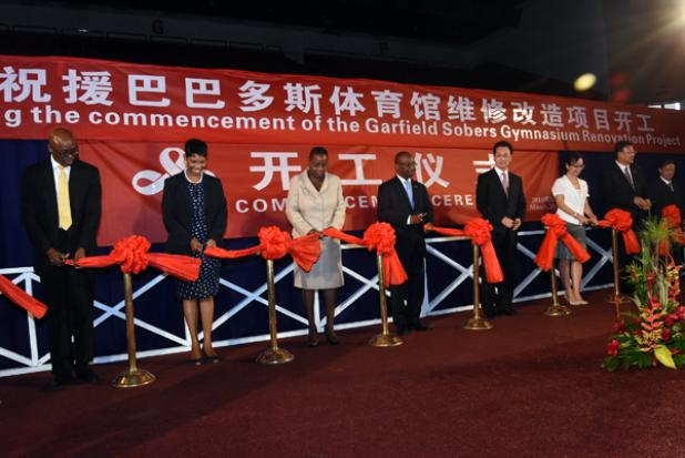 From left to right: Interim CEO of Gymnasium Ltd and the National Sports Council, Jerry Blenman; Lilian Rose of Gymnasium Ltd, Permanent Secretary in the Ministry of Culture, Sport and Youth, Ruth Blackman; Minister of Culture, Sport and Youth, Stephen Lashley; Vice Minister of Foreign Affairs for the People's Republic of China, Wang Chao; and Chinese Ambassador to Barbados, Wang Ke as they cut the ribbons to signal the closure of the Sir Garfield Sobers Gymnasium yesterday.