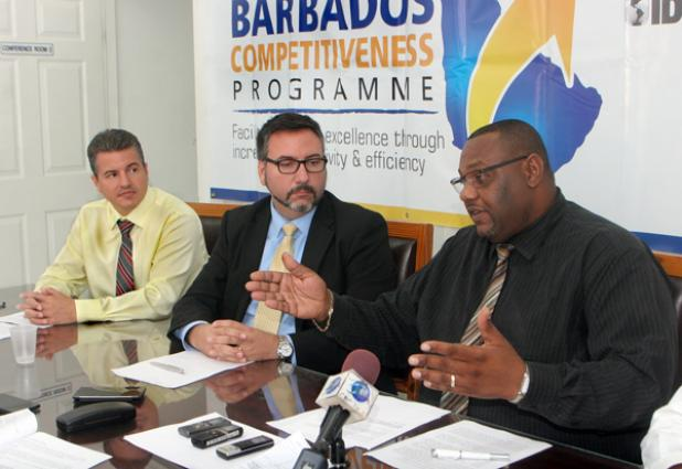 CAPTION: (Project Co-ordinator of the Barbados Competitiveness Programme Terry Bascombe (right) shares the benefits of the Electronic Single Window while Salvador Duart, Trade Facilitation advisor (left) and Daniel Rochon, Project Leader of consulting firm A-Solutions which has responsibility for the implementation of the EW, look on. pix - B'dos Competitiveness #1.jpg