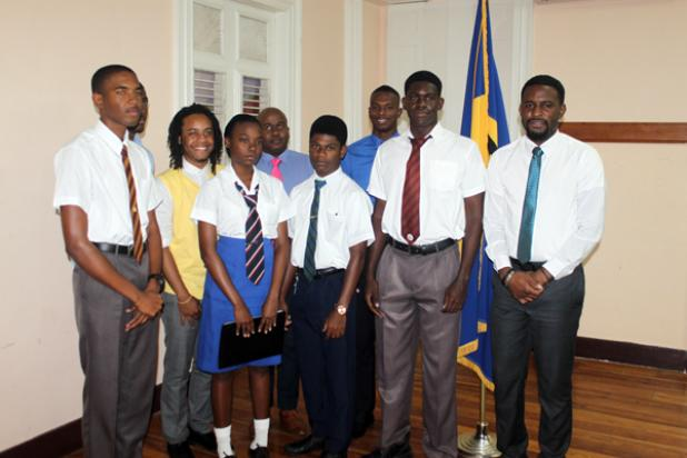 At the front, the four-member team: Harrison College's, Daveed Gittens and David Johnson; Queen College's, Nia Marshall; and The St. Michael School's, Dia Parris, who will be travelling to Germany standing with other members of the Barbados Debating Society.