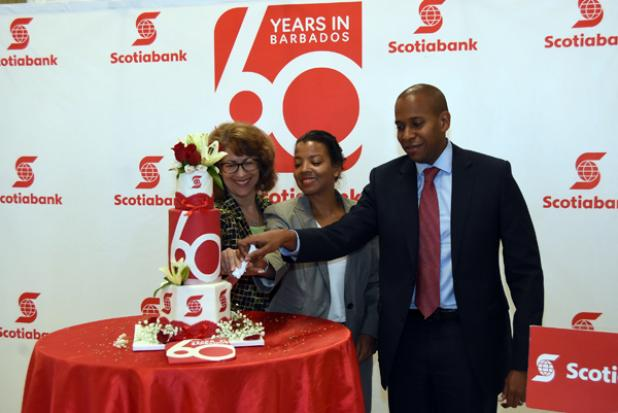 Managing Director, David Noel (right) Senior Marketing Manager, Lisa Cole (left) and Claire Jordan, Scotiabank's Director of Retail Banking cutting the Scotiabank Barbados' 60th Anniversary Celebration cake yesterday.
