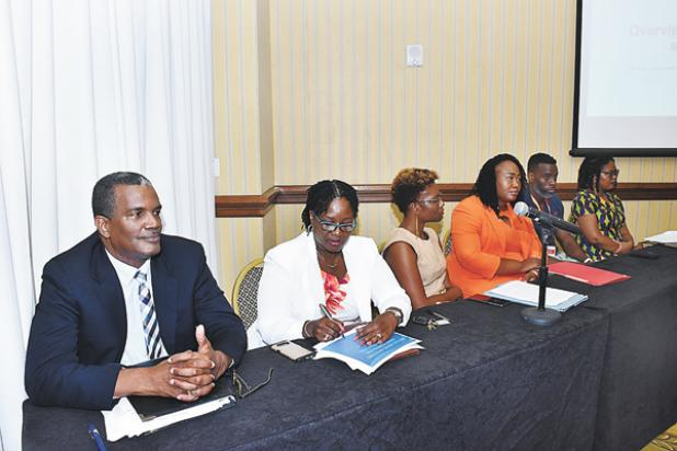 (FROM LEFT) Deputy Commissioner of Police, Erwin Boyce; Director of the Criminal Justice Research Unit, Cheryl Willoughby; Attorney at law and lecturer at UWI, Dr. Janeille Matthews; Lena Weekes, Sentence Manager, HMP Dodds; Dr. Corin Bailey, Senior Research Fellow; and Dr. Tonya Haynes, lecturer at UWI, made up the panel of the SALISES Symposium on Crime.