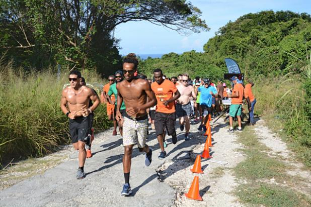 The participants of Barbadian Adventure Race are off to start the 10k Challenge at Pot House, St. John. From the far right, first place male finisher Randy Licorish led the group on Saturday. With 100 participants, the group raised $15,000 towards The Bahamas relief effort.