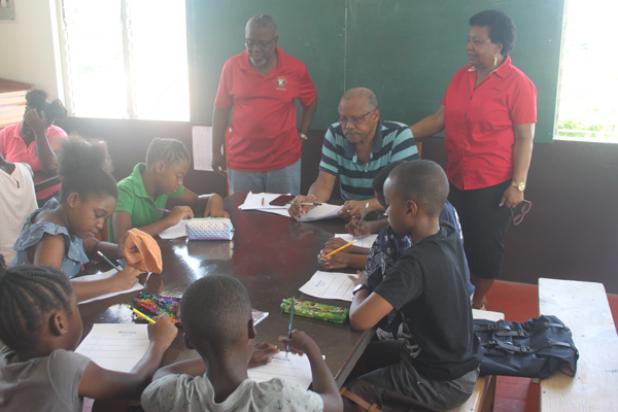 Secretary of the Kiwanis Club of Barbados North and Coordinator of the Lessons' Programme, Adrian Boyce, Tutor, Jeff Broomes and Distinguished Past President, Yvette Belgrave with some of the students who were at Saturday's session.