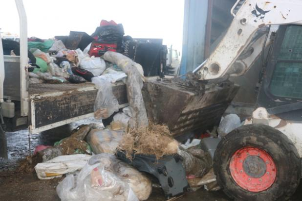 Drugs being removed from the truck to be placed in the incinerator.
