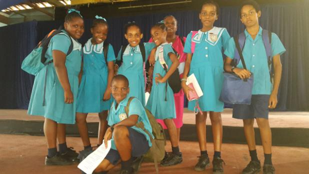 Students from St. Christopher's Primary with teacher, Angela Sealy Lewis (back), posing with students after their drama piece 'Barbados Journey to 50'.