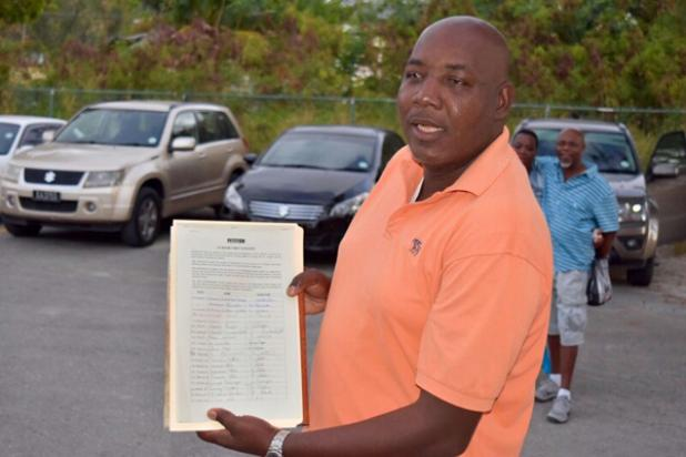 Ralph Blackman showing the petition to stop the closure of Belleplaine Police Station.