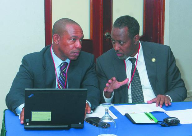 (left) Allan Smith, Secretary General of the Caribbean Postal Union engaging Bishar Hussein, Director General of the Universal Postal Union in conversation.