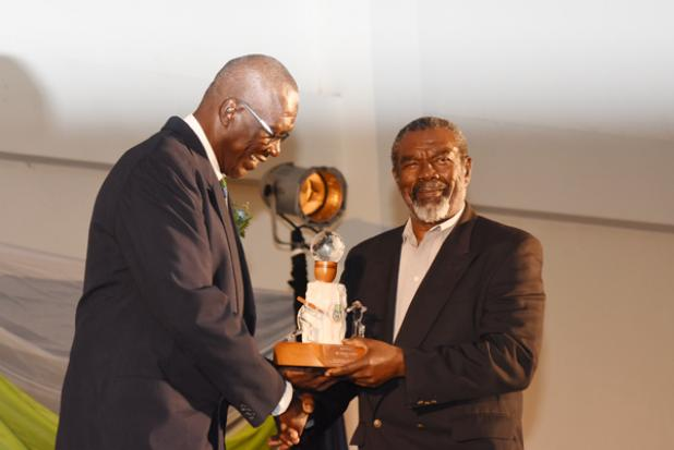 Former West Indies fast bowlers share a moment, as Charlie Griffith accepts his Special Appreciation Award from BCA President, Joel 'Big Bird' Garner.