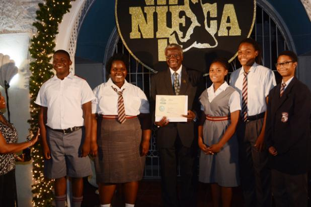 Members of the Coleridge and Parry School Choir accept their two NIFCA gold awards and three Incentive awards from Prime Minister, the Hon. Freundel Stuart.