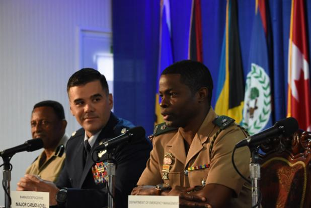 Host Nation Co-Director for Phase one of the Exercise TRADEWINDS 2017, Major Carlos Lovell (right), speaking during yesterday's launch, as Chief of the Office of Security Co-operation in the United States Military Liason Office, Lieutenant Colonel Jorge Jaramillo (centre), and Assistant Commissioner of Police, William Yearwood, look on.