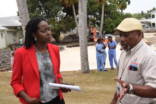 Deputy Director of CDEMA, Elizabeth Riley, and Chief Evaluator, Earl Arthurs, as they conversed on the fire drill.