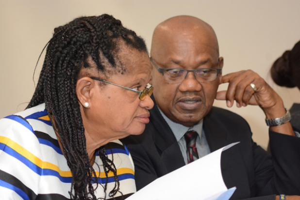(left) General Secretary of the National Union of Public Workers, Roslyn Smith, in conversation with President of the Congress of Trade Unions and Staff Associations of Barbados, Cedric Murrell, yesterday.
