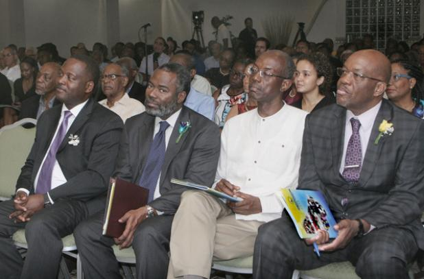 From left (front row) are Minister of Industry, International Business, Commerce and Small Business Development, Donville Inniss; Jefferson Cumberbatch, FTC Chairman; Professor Andrew Downes, Deputy Chairman; and Dr. Donley Carrington, Commissioner.