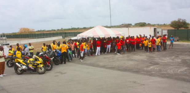 Hundreds gathered with their red and yellow shirts at Bushy Park Racing Circuit.