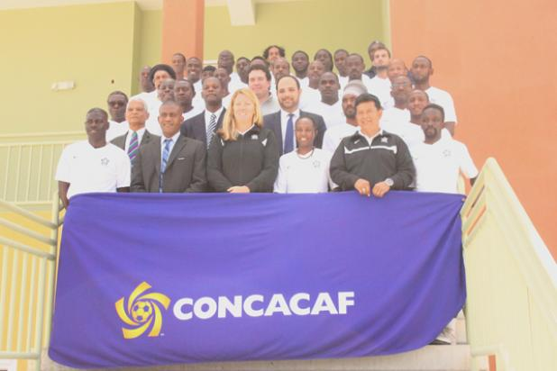 The coaches and instructors of the inaugural CONCACAF C License Coaching Course pose for the official photograph yesterday at the University of the West Indies' Usain Bolt Sports Complex.
