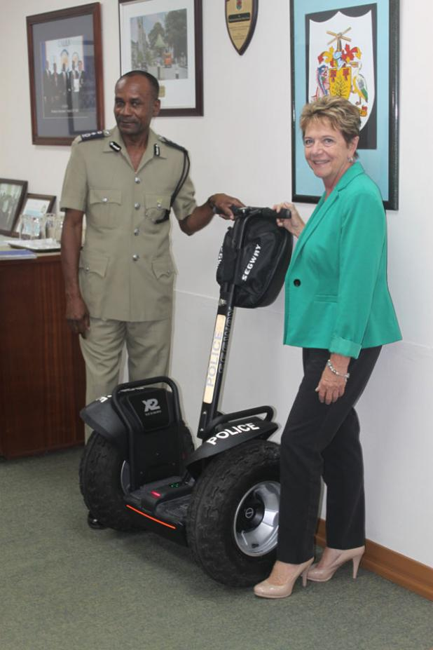 Chief Executive Officer of the Barbados Hotel & Tourism Authority (BHTA), Sue Springer, presenting one of the four segways to Acting Commissioner of Royal Barbados Police Force, Tyrone Griffith .