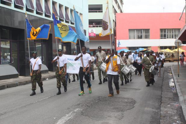 Barbados Defence Force members leading the way during yesterday's Walk For Peace in The City.