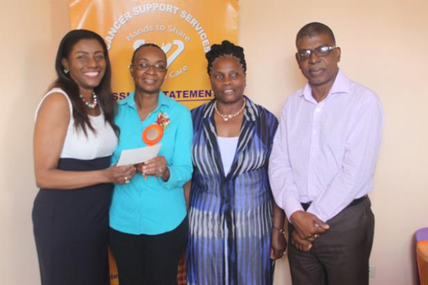 Deputy High Commissioner for Barbados to the United Kingdom, Alphea Wiggins, presenting the cheque to President of Cancer Support Services, Kathy-Ann Kelly-Springer. Also pictured are St. Laurence Church's Mothers' Union Leader, Beverley Lashley and Cancer Support Services Public Relations Officer, Antoine Williams.