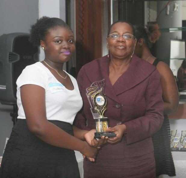 Combermere's Micarla Archer proudly receives her award for the Most Outstanding Female and Overall Outstanding Participant.