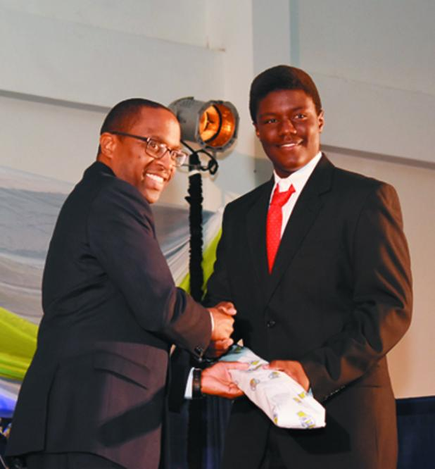 School's Division Batsman with the Highest Score of 138, Shaine Bathwaite of the Combermere School, receiving his award.
