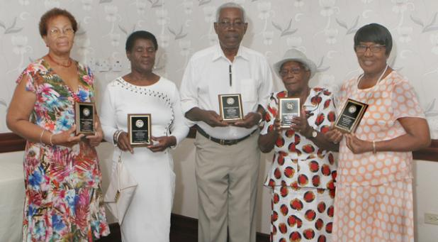 (From left) President of the St. Matthew's Old Scholars and Friends Association, Monica Hendricks, along with Past Presidents Angela Beckles, Othniel Moore, Hazel Roissetter and Betty Haynes, with their awards.