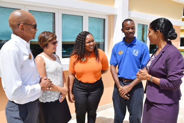 Two of the Ocean Two Resort staffers in the NVQ programme in Customer Service, Sadie White (third from right) and Dwayne Greenidge (second right), in conversation with Labour Minister, Senator Esther Byer-Suckoo, General Manager, Paul Collymore (left) and Group General, Manager Patricia Dass.