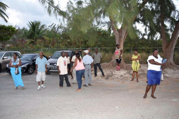 Residents of St. Andrew gathered in the school yard of The Alleyne School, after walking out of the Town Hall meeting put on by the Royal Barbados Police Force, about the relocation of Belleplaine Police Station.