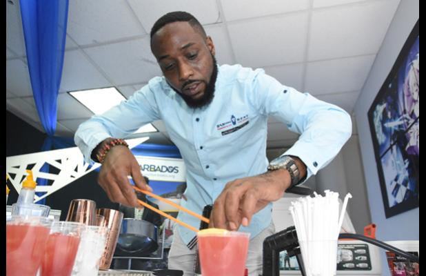 Award-winning mixologist, David Barker, put his spin on cocktails with locally-produced ingredients during the official launch of Tourism Week 2018 at the Warrens Entertainment Centre yesterday morning.