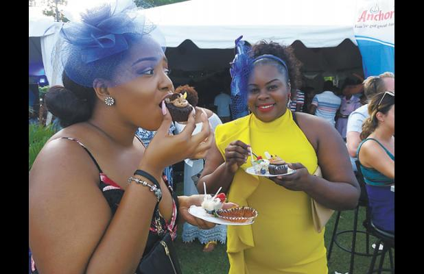 Deborah Bartlett (left) and Connie Drayton enjoyed some of the delectable dishes at the Taste of the Spirits Polo event held yesterday evening.
