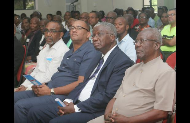 FROM LEFT: Minister of Energy Senator Darcy Boyce; Minister of Tourism Richard Sealy; Prime Minister Freundel Stuart; and Former BWU General Secretary Sir Roy Trotman paying close attention to the speakers.