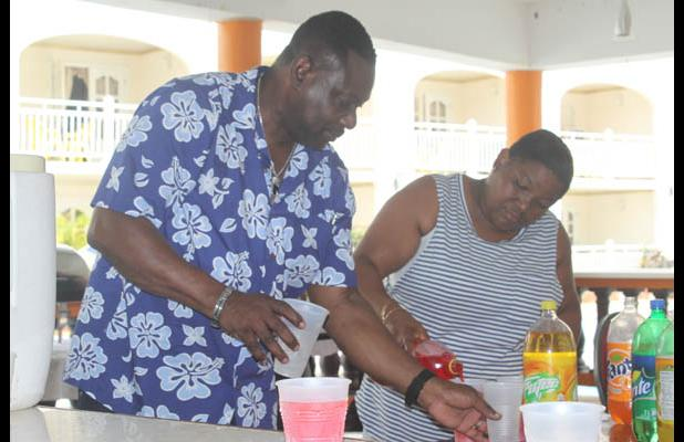 Member of Parliament for the St. Michael Central constituency, Steven Blackett, helping to share the drinks for the youngsters.