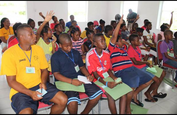 Project S.O.F.T (Safeguarding Our Future Today) campers take in the information given during the session on juvenile  delinquency.