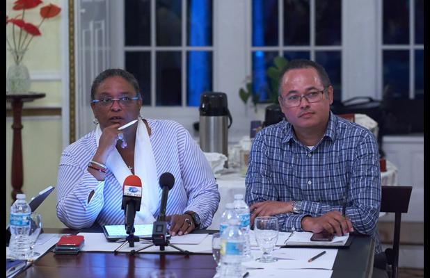 (Left) Prime Minister Mia Mottley seen here during the press conference with Managing Director of BL&P Roger Blackman.