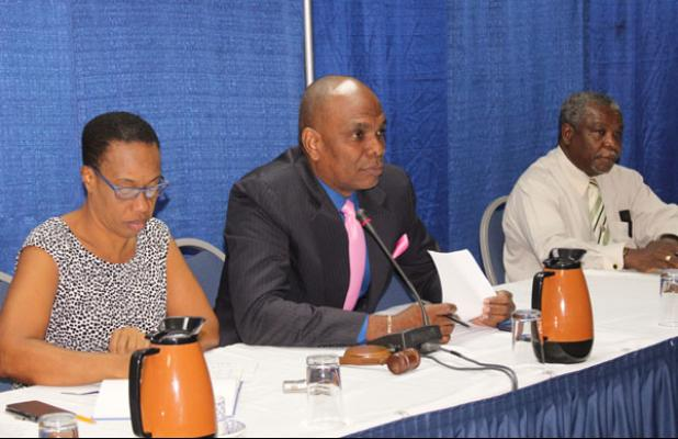 Timothy Nicholls (centre), 1st Vice President of the Barbados Association of Insurance and Financial Advisors (BARAIFA), sits with treasurer, Trevor Mapp (right) and secretary, Wendy Norville, during the opening of the conference.