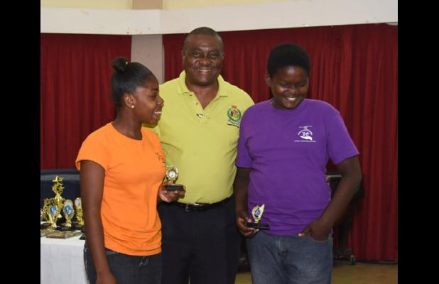 Faith Brewster and Ramon Austin both received prizes for Best at Jewellery from  Inspector Stephen Griffith.